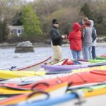 PADDLEFEST-GOERS bundle up against the breeze from Wickford Harbor. /