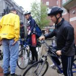 MAYOR DAVID N. CICILLINE, right, and other city commuters brave the rain this morning in Providence to participate in Bike to Work Day. The annual RIDOT event promotes bicycling as a healthful means of reducing energy use, pollution and rush-hour traffic.  /