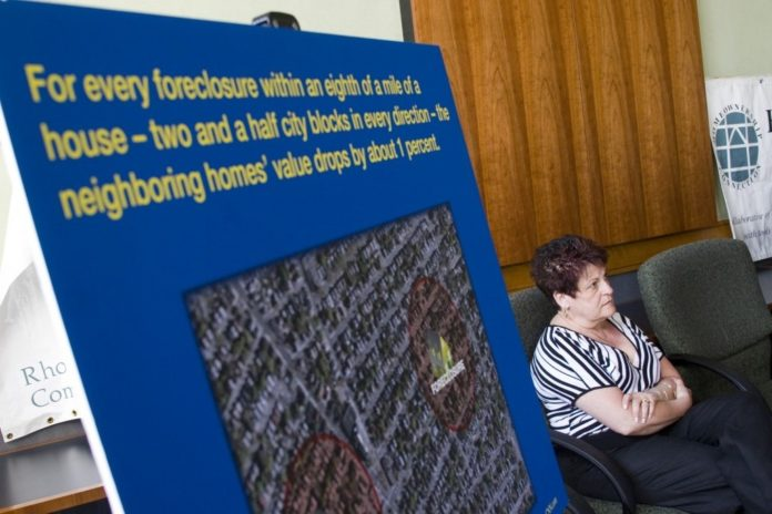 HOMEOWNER Eleanor Martin, who managed to escape an ARM whose payments would have risen beyond her means, spoke at U.S. Sen. Jack Reed's unveiling of legislation to expand federal foreclosure-prevention services. /