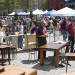 SHOPPERS BROWSE the crafts, antiques, fruit, vegetables and other products of the Providence Open Air Market, which is slated continue Saturdays, from 11 a.m. to 5 p.m., through October. /