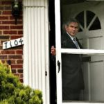 PAUL WOLFOWITZ leaves his home in Chevy Chase, Md., on May 18, the day after announcing his resignation as World Bank president, effective June 30. /