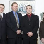 BOB MacKENZIE, Amica vice president and corporate secretary, second from left, is joined by three URI business students - David Hathaway, left, Ryan Yenulevich and Andrea Bernier, right - after a luncheon honoring scholarship recipients. /