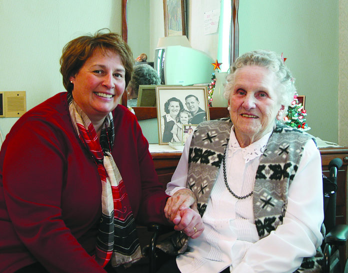DOROTHY EDWARDS, right, a nursing home resident and longtime Hope & Hospice Care of Rhode Island patient, sits with her nurse and case manager, Linda Tolmie. /