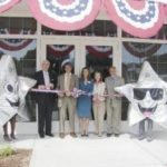 AT THE RIBBON-CUTTING Thursday for the Oaklawn Avenue branch are, from left: Jack F. Treanor, Washington Trust president and COO; Cranston Mayor Michael Napolitano; Elaine deCiutiis, a assistant VP and branch manager for the new branch; Paula Rocha, Cranston's director of economic development; and Mike Salvadore of the Cranston Chamber of Commerce. A grand opening celebration is set for Saturday, June 16, from 10 a.m. to noon. /