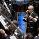 TRADERS WORK on the floor of the New York Stock Exchange in New York City today,  as U.S. stocks retreated after Bear Stearns Cos.' plan to bail out a money-losing hedge fund sparked fears that mortgage bond losses may be worse than was previously believed. /