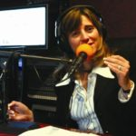 VANESSA TOLEDO-VICKERS tapes her show, which focuses on business issues, at Latino Public Radio last Wednesday. /