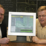 URI OCEAN ENGINEERING Prof. Malcolm Spaulding, left, the director of the new undersea center, shows off his CoastMap software program along with colleague Eoin Howlett. /