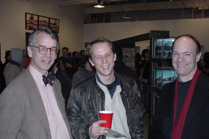 TIMOTHY MORE, left, is a lawyer who represents many artists and has been involved with projects including Monohasset Mill. Above, he attends a oparty with artist Erik Bright, center, and Clark Schoettle of the Providence Preservation Society. /