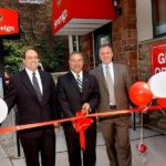 SOVEREIGN BANK's Brian Azar, left, R.I. community banking regional executive; Steve Issa, center, New England South CEO; and Tim Monahan, R.I. community banking area manager, at the ribbon-cutting ceremony. /