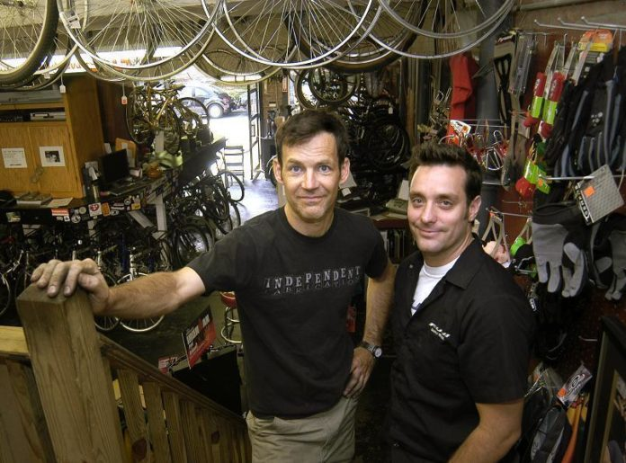 THE HUB Bike Culture owners  Jack Madden, left, and Jesse Bushnell, say their East Side bicycle shop can provide a more personal touch than the big-box stores because of their own knowledge and experience. /