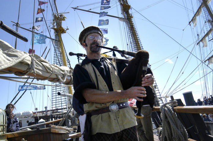 CHARLIE RAFERTY  plays the bagpipe aboard the 65-foot Continental Sloop Providence, a replica of the first vessel commanded by John Paul Jones during the Revolutionary War. /