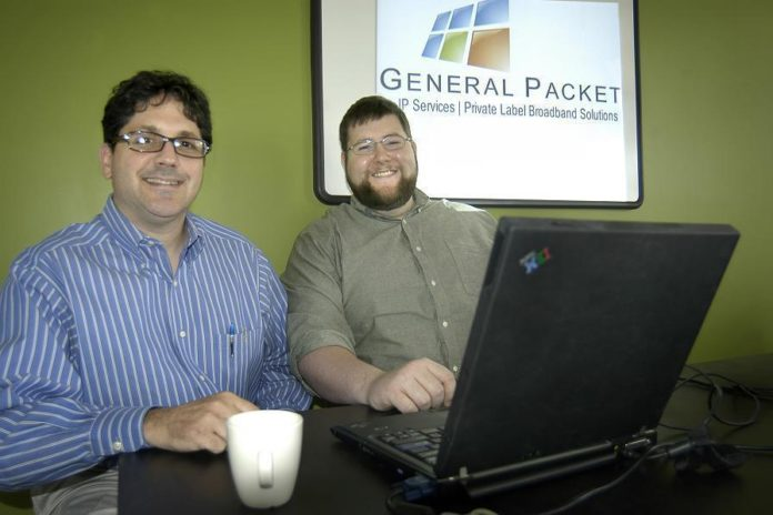 DENNIS DIBATTISTA, left, president, and Edward McConnell, director of applications development, at General Packet, a small tech firm in Pawtucket that specializes in IP services and private-label broadband services for businesses. /
