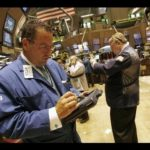 TRADERS ARE BUSY on the floor of the New York Stock Exchange as equities extend a rally that started Monday. /