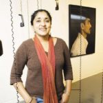 AT THE URI Fine Arts Center, above, is Annu Palakunnathu Matthew, during an exhibit last fall that chronicled the Americanization of call-center workers in India. The recorded interviews and photographs were the product of a one-year sabbatical. /