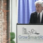 SCOTT WOLF, executive director of Grow Smart Rhode Island, speaks at a press conference on the historic tax credit at Hope Artiste Village last week. /