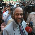 IPCC CHAIR Rajendra Pachauri speaks to reporters today in New Delhi, after learning that his U.N. panel will share the 2007 Nobel Peace Prize with Al Gore. /