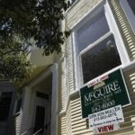CONDO PRICES in Massachusetts fell 2.9 percent in the third quarter, as sales fell 6.0 percent, The Warren Group said. Above, a sign advertises a unit for sale this summer in the Haight-Ashbury section of San Francisco. /