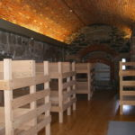 THE RESTORED military barracks can accommodate about 40 people in two large bunk rooms and a separate, smaller room for adult chaperones. /