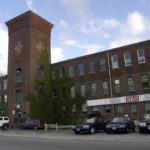 THE MILL COMPLEX at 560 Mineral Spring Ave. in Pawtucket is now occupied by small businesses and artists, but on the outside, it remains industrial-looking. /
