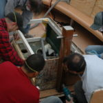STUDENTS at the International Yacht Restoration School rebuild the engine box of a harbor launch, as part of Skill Up Rhode Island. /