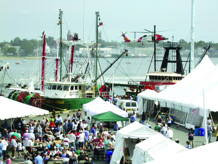 NEW BEDFORD's working waterfront is celebrated in an annual festival that draws thousands to dockside. /