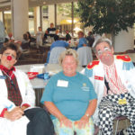CLOWN TIME: Dr. Bounce and Nurse BB helped employee Beverly Freitas reduce stress at a recent Rhode Island Hospital/Hasbro Children's Hospital Stress Less health fair, an event run by Lifespan for its workers. /