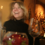 "WINE CONSULTANT Maggie Dey enjoys the ambiance at 1149 Restaurant during a recent ""Wine Divas"" night. /"