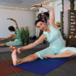 KAREN LEE, a yoga teacher and therapist with Breathing Time Yoga in Pawtucket, offers corporate classes during lunch or after work. /
