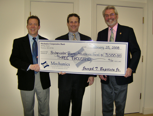 JOSEPH T. BAPTISTA JR., center, Mechanics Cooperative Bank president and CEO,  presents a check for $3,000 to Ron Adams, right, and Timothy P. O'Leary, left, of the Bridgewater Cares Family Fund. /