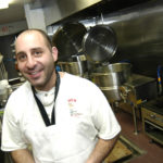 OWNER DAVID GRAVINO, in the expanded kitchen of Iggy's Doughboys and Chowder House, at Oakland Beach in Warwick. /