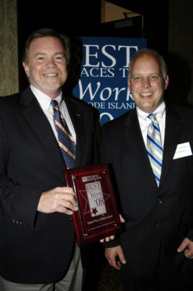 PBN Publisher Roger Bergenheim(r) presents Anthony Maione, Executive Director for United Way of RI, with their award. / PBN Photo/Frank Mullin