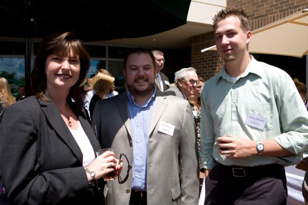 Honoree Kristin Fraser with KPMG colleagues Justin Duquette(l) and Andrew Bicknell. / PBN Photo/Stephanie Ewens