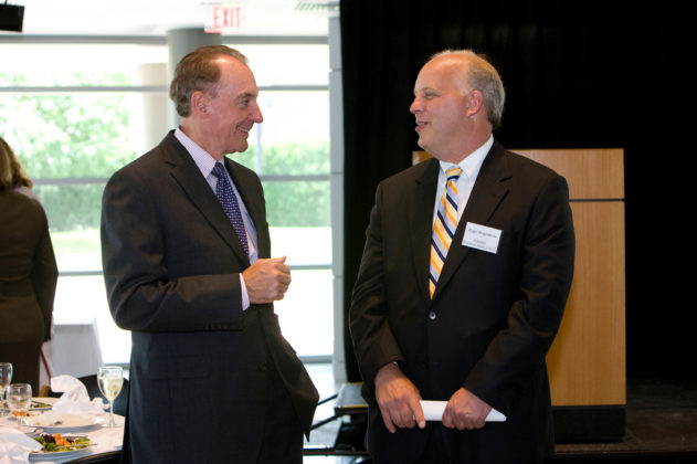 Bryant University President, Ronald Machtley(l), with PBN Publisher Roger Bergenheim. / PBN Photo/Stephanie Ewens
