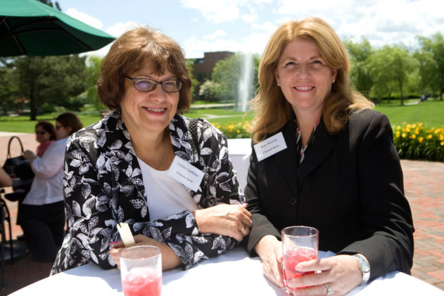 Linda Caulkins(l) and Joan Rotella, Citizens Bank, enjoy the outdoor cocktail reception. / PBN Photo/Stephanie Ewens