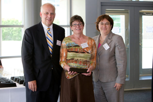 Honoree Margaret Howard (center), TLCare Wear, with PBN Publisher Roger Bergenheim and Linda Simmons, CFO, Bank Rhode Island. / PBN Photo/Stephanie Ewens
