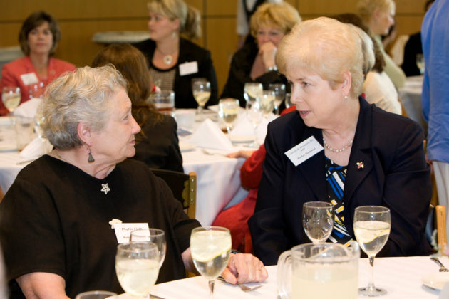 Honoree Dr. Patricia Recupero(r), CEO of Butler Hospital,shares a moment with Phyllis Field, also of Butler Hospital. / PBN Photo/Stephanie Ewens