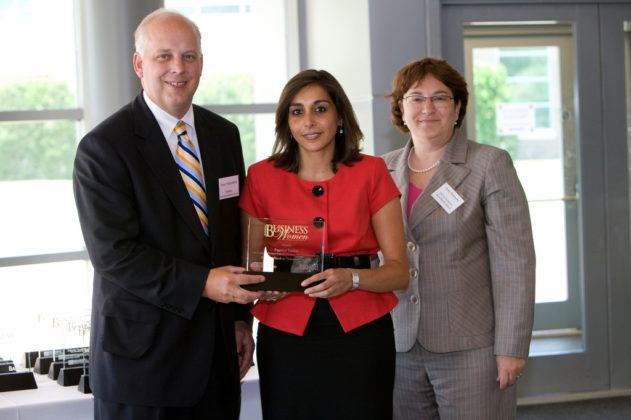 Honoree Papatya Tankut (center), of CVS Corp, accepts her award from PBN Publisher Roger Bergenheim and Bank Rhode Island CFO, Linda Simmons. / PBN Photo/Stephanie Ewens