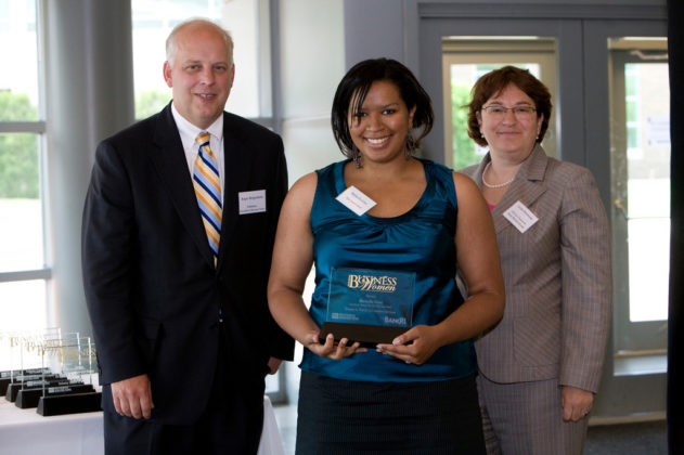 PBN Publisher Roger Bergenheim and Bank Rhode Island CFO, Linda Simmons(r), present Michelle Cruz, of The Lost Chord, with her award. / PBN Photo/Stephanie Ewens