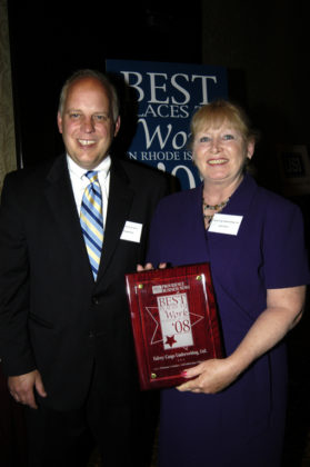 Jane Falvey, of Falvey Cargo Underwriting, Ltd., accepts their award for winning in the Small Category from PBN Publisher Roger Bergenheim. / PBN Photo/Frank Mullin