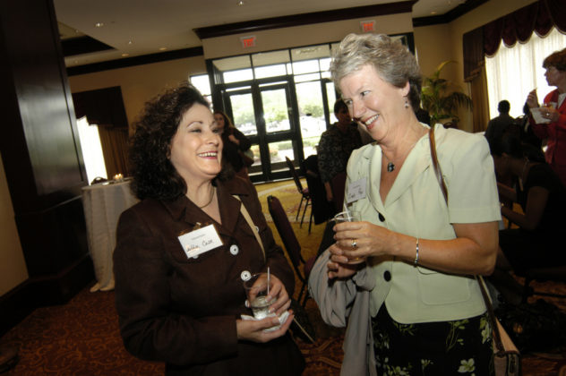 Debbie Case(l) and Cindy Roy, of Edward Jones, mingle during the cocktail reception portion of the evening. / PBN Photo/Frank Mullin