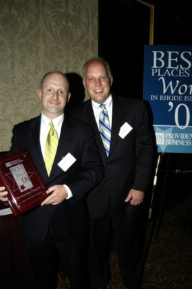 PBN Publisher Roger Bergenheim(r) presents Frank Conner, of Taylor Duane Barton & Gilman, LLP, with their award for winning in the Small Category. / PBN Photo/Frank Mullin