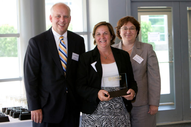 PBN Publisher Roger Bergenheim(l), Honoree Maria Montanaro, Thundermist Health Center, and Linda Simmons, Bank Rhode Island CFO. / PBN Photo/Stephanie Ewens