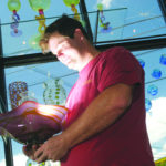 EBEN HORTON, owner of the The Glass Station, first developed a love for glass as a child. In 2000, he opened the commercial glass studio in Wakefield. /
