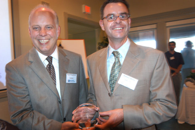 Patrick Quinn(r), of Tofias PC, accepts his award from PBN Publisher Roger Bergenheim. / PBN Photo/Frank Mullin
