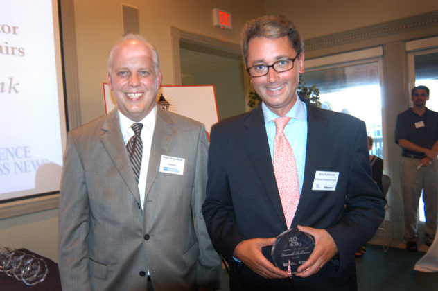 Honoree Ken Robinson, Citizens Bank, accepts his award from PBN Publisher Roger Bergenheim. / PBN Photo/Frank Mullin