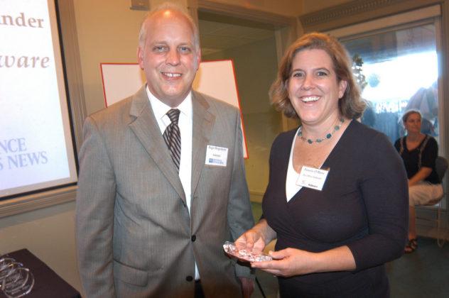 Pamela O'Hara, of BatchBlue Software, accepts her award from PBN Publisher Roger Bergenheim. / PBN Photo/Frank Mullin