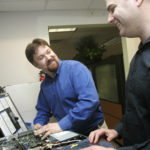 TODD KNAPP, left, president of Envision Technology Advisors, says his company is more of a business-consulting firm that specializes in technology than a traditional IT firm. With him is Mike Ando, right, a virtualization specialist. /