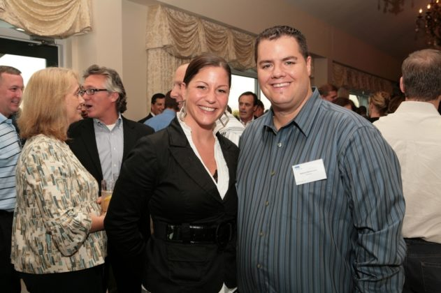 Amy Briggs and Anthony Bettencourt, both of Shazamm, enjoy the evening's cocktail reception. / PBN Photo