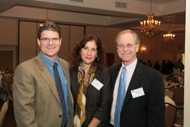 Jim Hanrahan(l), Joyce Rylander and Dave Dunbar, all of Providence Business News, enjoy the festivities. / PBN Photo