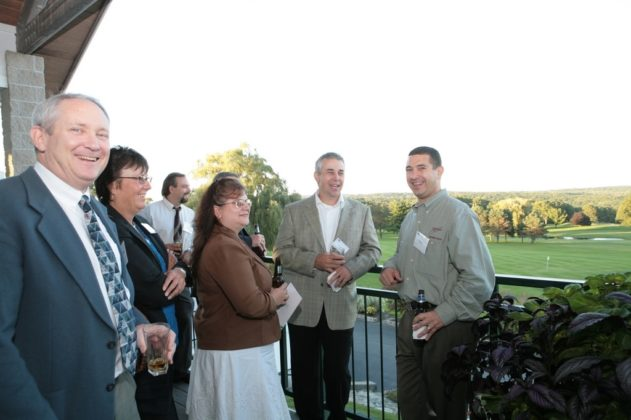 The lush green landscape of Kirkbrae Country Club serves as a perfect backdrop for guests enjoying the event's cocktail reception. / PBN Photo